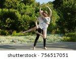 girl assisting girl doing ballet