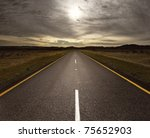 straight tar road leading into... | Shutterstock . vector #75652903