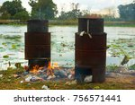 people are burning garbage | Shutterstock . vector #756571441