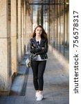 a woman walks around the city... | Shutterstock . vector #756578317