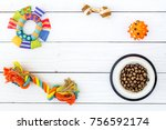 Stock photo concept pet care playing and training toys accessories and feed on white wooden background top 756592174