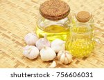 garlic oil with garlic | Shutterstock . vector #756606031