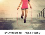 young fitness woman jumping...   Shutterstock . vector #756644059