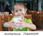 cute little asian girl holding... | Shutterstock . vector #756644359
