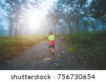 a child walks a way in forest... | Shutterstock . vector #756730654