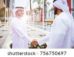 arabic businessman giving an... | Shutterstock . vector #756750697