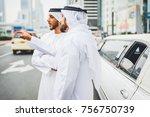 two arabian businessmen talking ...   Shutterstock . vector #756750739