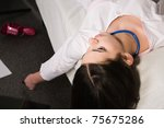 Lifeless young nurse lying on the sofa - stock photo