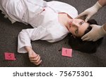 Forensic expert collecting evidence in a crime scene - stock photo