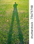 Man S Shadow On The Green Grass