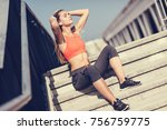 fit sporty woman sitting and... | Shutterstock . vector #756759775