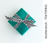 green gift box with black and... | Shutterstock . vector #756759841