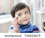 cute little boy holding one...   Shutterstock . vector #756823675