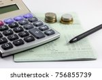 Small photo of Saving account book. Includes a calculator, pen, and a blank coin on the account book