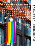 Small photo of Gay Village decoration detail in the daytime. Old architecture building, the rainbow flag, and the traditional plastic balls define the city touristic gay neighborhood