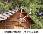 The Peaked Roof Of A Wooden...