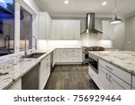 Stock photo large spacious kitchen design with white kitchen cabinets white kitchen island with lots of 756929464
