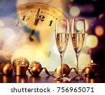 champagne glasses and clock at... | Shutterstock . vector #756965071