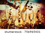 champagne glasses and clock at... | Shutterstock . vector #756965431