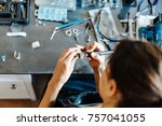 the girl works on a jewelry in... | Shutterstock . vector #757041055