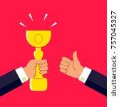 hand holding a winner's trophy...   Shutterstock .eps vector #757045327