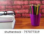 colored pencils on wooden desk... | Shutterstock . vector #757077319