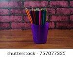 colored pencils on wooden desk... | Shutterstock . vector #757077325