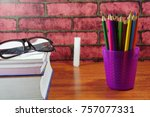colored pencils on wooden desk... | Shutterstock . vector #757077331