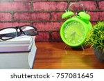 books  desk clock  glasses and... | Shutterstock . vector #757081645