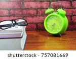 books  desk clock  glasses and... | Shutterstock . vector #757081669