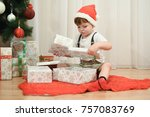 little boy opening a christmas... | Shutterstock . vector #757083769