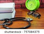 books  desk clock  stethoscope... | Shutterstock . vector #757084375