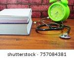 books  desk clock  stethoscope... | Shutterstock . vector #757084381