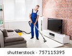 smiling young male janitor... | Shutterstock . vector #757115395
