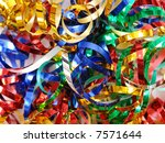 Closeup of twisted and tangled party streamers in blue, silver, red, green and golden color - stock photo