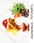 Small photo of Foie gras with vegetable and fruit in white plate