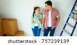portrait of young couple moving ... | Shutterstock . vector #757239139