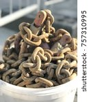 Small photo of Chain rusted chain chain on a bucket