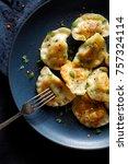 fried dumplings  pierogi with... | Shutterstock . vector #757324114