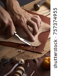 man working with leather | Shutterstock . vector #757374955