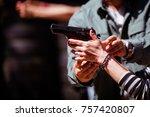 young woman firing a 9 mm... | Shutterstock . vector #757420807