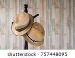 Straw Hat Hanging On Wooden...