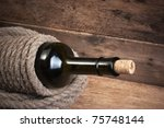 old  bottle of wine on the board   Shutterstock . vector #75748144