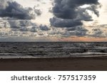 stormy waves on sunset beach.... | Shutterstock . vector #757517359