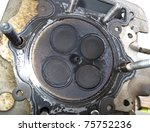 Cylinder head of a motorcycle engine with four valves - stock photo