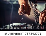 disc jockey at the turntable.... | Shutterstock . vector #757543771