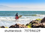 surfer and his surfboard. | Shutterstock . vector #757546129