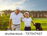 happy man with his son golfers... | Shutterstock . vector #757547437