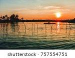 a lone fisherman in a boat on... | Shutterstock . vector #757554751