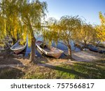 a willow and boat on the shore... | Shutterstock . vector #757566817